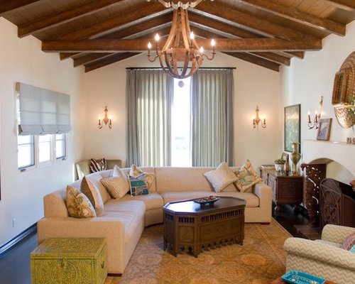 Example Of A Tuscan Living Room Design In Los Angeles With Standard Fireplace