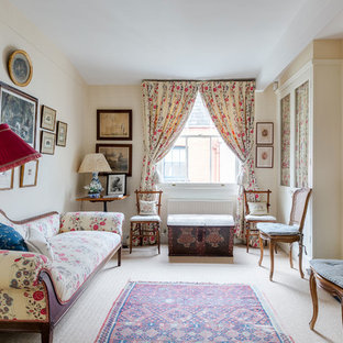 This is an example of a medium sized victorian formal enclosed living room in London with beige walls, carpet, no tv, beige floors and a standard fireplace.