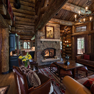 Medium sized rustic formal open plan living room in Denver with brown walls, light hardwood flooring, a standard fireplace, a stone fireplace surround and no tv.
