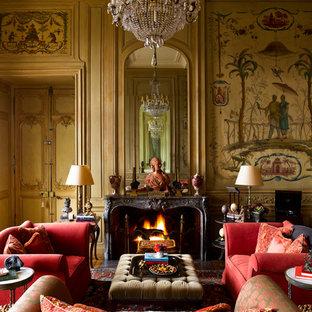 Idée de décoration pour un grand salon tradition fermé avec une salle de réception, un mur multicolore, une cheminée standard et aucun téléviseur.