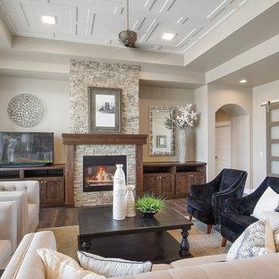 Ejemplo de salón clásico con paredes beige, suelo de madera oscura, chimenea tradicional, marco de chimenea de ladrillo y suelo marrón