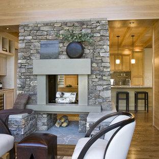 シャーロットの大きいトラディショナルスタイルのおしゃれなLDK (フォーマル、マルチカラーの壁、濃色無垢フローリング、両方向型暖炉、石材の暖炉まわり、テレビなし、茶色い床) の写真