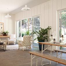 Farmhouse Living Room by Houseplans Studio