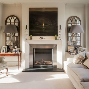 Mid-sized transitional formal carpeted living room photo in London with beige walls, a standard fireplace, no tv and a metal fireplace