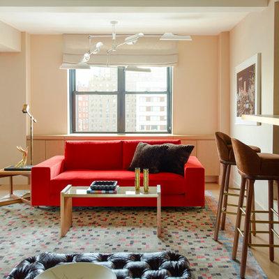 Example of a trendy open concept light wood floor living room design in New York with beige walls