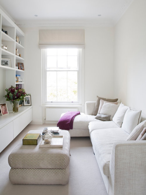 Trendy Enclosed Carpeted Living Room Photo In London With White Walls