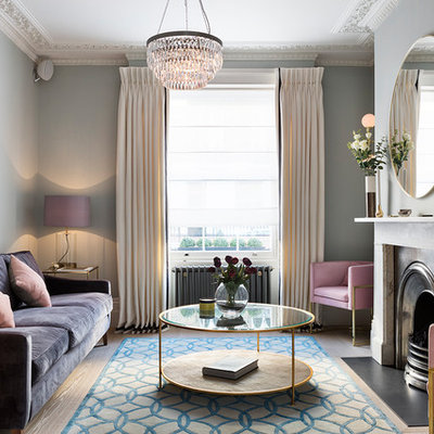 Living room - transitional enclosed and formal light wood floor and beige floor living room idea in London with a standard fireplace, a stone fireplace, blue walls and no tv