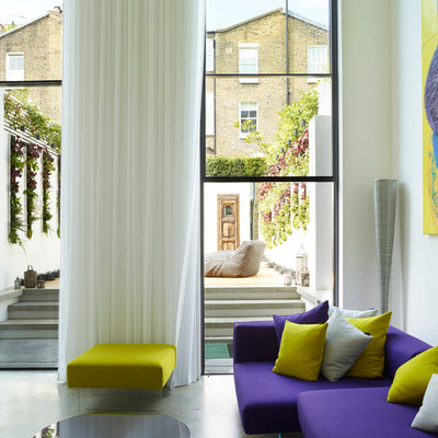 Inspiration for a huge contemporary open concept concrete floor and gray floor living room remodel in London with white walls
