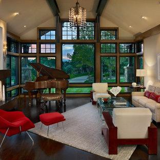 Foto de salón con rincón musical abierto, actual, de tamaño medio, sin televisor, con paredes beige, suelo de madera oscura, chimenea tradicional y marco de chimenea de yeso