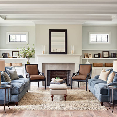 Inspiration for a transitional formal light wood floor living room remodel in Charlotte with gray walls, a standard fireplace and no tv