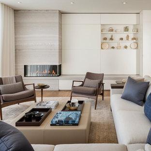 Immagine di un soggiorno contemporaneo aperto con camino ad angolo