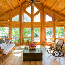 Traditional Living Room by Katahdin Cedar Log Homes