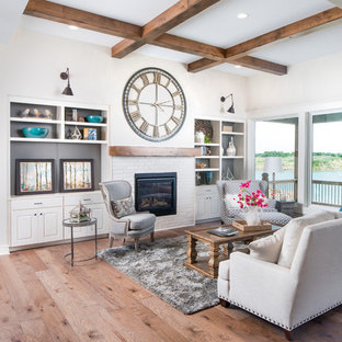 Inspiration for a mid-sized beach style open concept light wood floor living room remodel in Wichita with beige walls, a standard fireplace and a brick fireplace