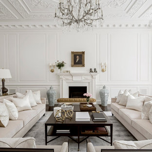 Design ideas for a large traditional formal open concept living room in London with white walls, a standard fireplace, a plaster fireplace surround and no tv.