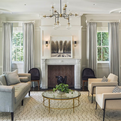 Example of a mid-sized transitional formal and open concept dark wood floor and brown floor living room design in New York with gray walls, a standard fireplace, a stone fireplace and no tv