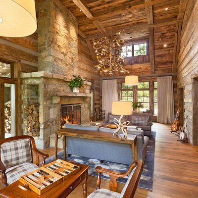 Mountain style living room photo in Other with a music area, a standard fireplace, a stone fireplace and no tv