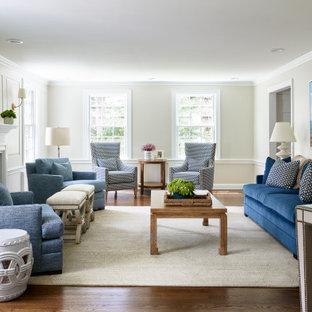 Foto på ett mellanstort vintage separat vardagsrum, med beige väggar, mörkt trägolv, en standard öppen spis, en spiselkrans i sten och brunt golv