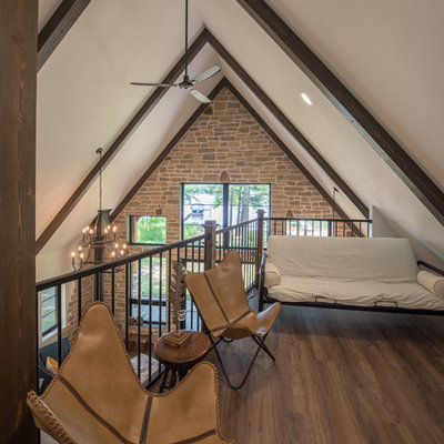 Inspiration for a small rustic formal and loft-style medium tone wood floor and brown floor living room remodel in Minneapolis with beige walls and no tv