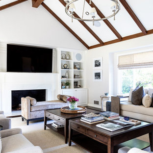 Example of a mid-sized farmhouse enclosed medium tone wood floor living room design in Los Angeles with beige walls, a standard fireplace, a concrete fireplace and a wall-mounted tv