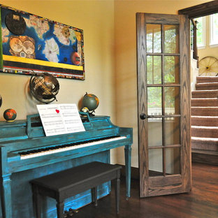 Inspiration for an eclectic enclosed living room remodel in Dallas with a music area and yellow walls