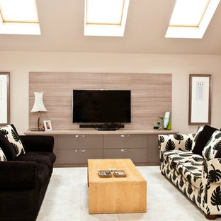 Contemporary living room in Cambridgeshire with beige walls and a wall mounted tv.
