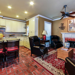 Design ideas for a large classic formal open plan living room in New Orleans with brick flooring, brown walls, a standard fireplace, a brick fireplace surround and no tv.