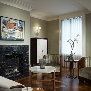 Trendy dark wood floor living room photo in Chicago with a standard fireplace