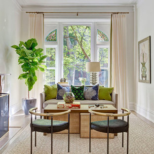 Inspiration for a contemporary enclosed medium tone wood floor living room remodel in Los Angeles with white walls, a standard fireplace and no tv