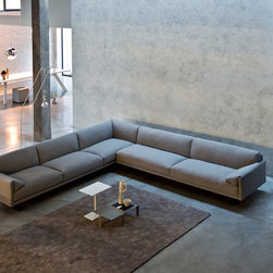 """Chicago Sectional - Metropolitan elegance, lightness of sign, balance in its proportions and excellent seat comfort are the concepts characterizing this design. With low or high back-rest cushions, and with or without mechanism. The supporting frame is in metal section properly reinforced and in multilayer wood. The spring system of the seat is made of elastic crossed belts. The filling is in C.F.C. - free, non - deformable polyurethane foam. The seat cushions are in selected and sterilized 70% goose feather and 30% duck feather """"Assopiuma"""" with supporting heart in C.F.C. - free, non - deformable polyurethane foam, covered by a layer of viscoelastic foam and with covers in fabric 100% cotton. Slide feet in drawn metal with epoxy varnished finishing in colors black or white. Completely removable covers except for the leather version."""