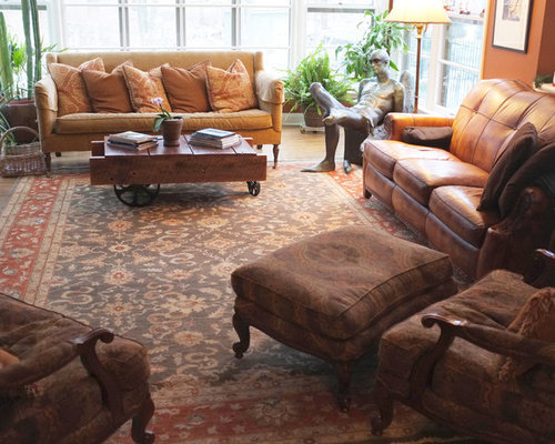 Example Of A Large Classic Formal And Enclosed Medium Tone Wood Floor Living Room Design In