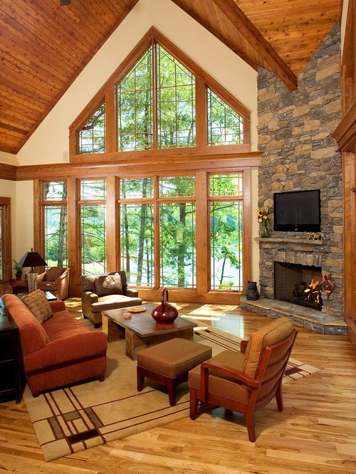 Example Of A Mountain Style Living Room Design In Other With A Corner  Fireplace And A