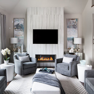Example of a mid-sized trendy enclosed dark wood floor and white floor living room design in Other with gray walls, a ribbon fireplace, a wall-mounted tv and a tile fireplace