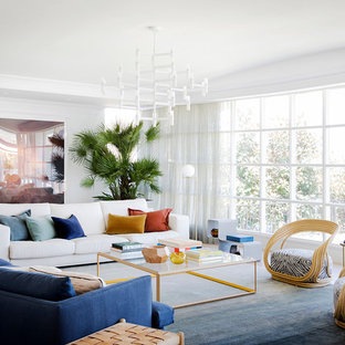 Design ideas for a contemporary living room in Sydney with white walls, light hardwood floors and brown floor.