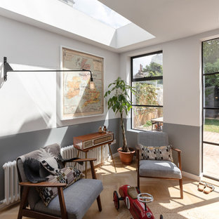 Inspiration for a medium sized retro enclosed living room in Oxfordshire with light hardwood flooring and white walls.