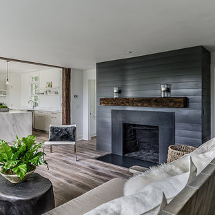 Example of a mid-sized country open concept living room design in New York with a standard fireplace and gray walls