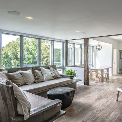 Inspiration for a contemporary open concept living room remodel with white walls