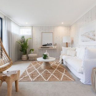 Inspiration for a beach style living room in Geelong with white walls, carpet and grey floor.