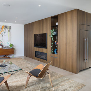 Contemporary open concept living room in Perth with white walls and grey floor.