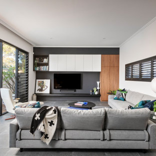 Inspiration for a large contemporary open concept living room in Perth with white walls, a built-in media wall and grey floor.