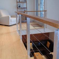 Modern Living Room by Rob Kane - Kitchen Interiors Inc.