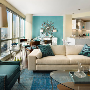 Inspiration for a small contemporary open concept living room in New York with blue walls.