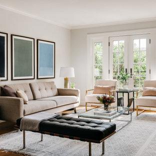 Idéer för att renovera ett mellanstort vintage separat vardagsrum, med vita väggar, mellanmörkt trägolv och brunt golv