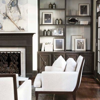 Inspiration for a large timeless enclosed dark wood floor living room remodel in Other with white walls, a standard fireplace, no tv and a tile fireplace