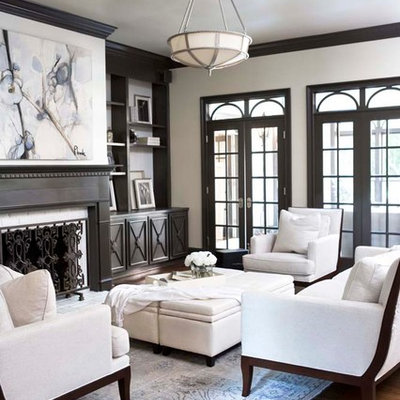 Example of a large classic enclosed dark wood floor living room design in Other with white walls, a standard fireplace and no tv