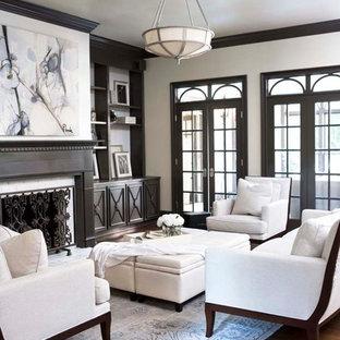 Immagine di un grande soggiorno classico chiuso con pareti bianche, parquet scuro, camino classico e nessuna TV