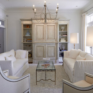 Inspiration for a large timeless formal and enclosed dark wood floor living room remodel in New Orleans with white walls and a concealed tv