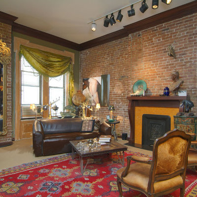 Inspiration for a mid-sized eclectic enclosed carpeted living room remodel in New York with a standard fireplace and a wood fireplace surround