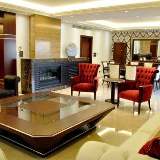 トロントの広いコンテンポラリースタイルのおしゃれなLDK (フォーマル、ベージュの壁、大理石の床、石材の暖炉まわり、内蔵型テレビ、横長型暖炉) の写真