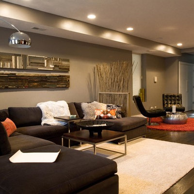 Example of a large minimalist formal and open concept dark wood floor living room design in Chicago with no fireplace, a media wall and gray walls