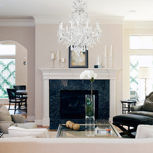 Inspiration for a traditional enclosed living room in Houston with beige walls, no tv and medium hardwood floors.